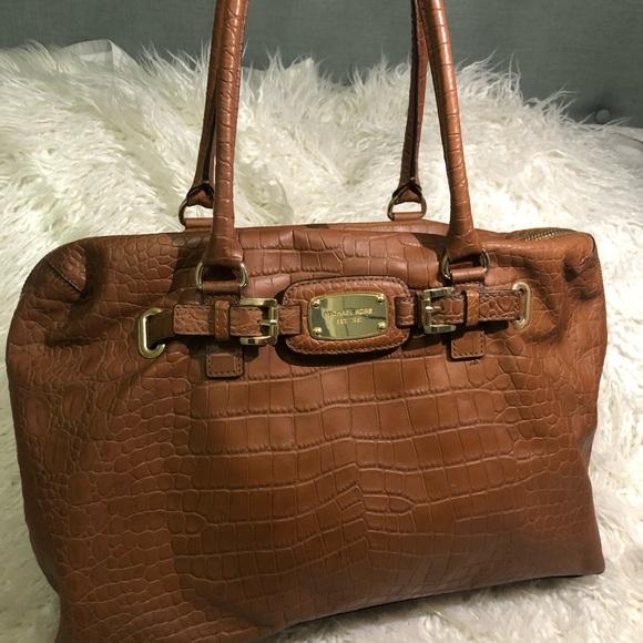 Michael Kors Handbags - Michael Kors embossed leather carryon